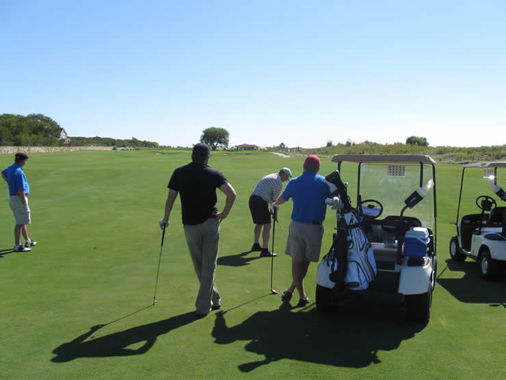 Golfers Enjoying a Round of Golf on the Bill and Payne Stewart Golf Course